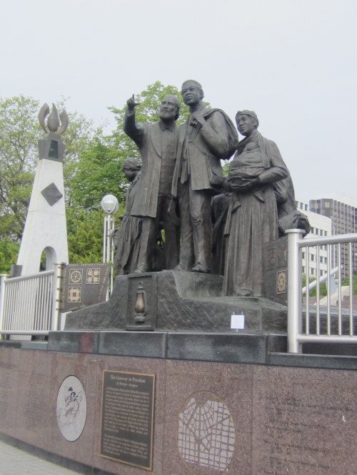 poem is on right-hand base of statue