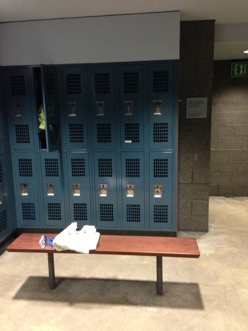 second top locker from the right. . . poem is peeking through the grate