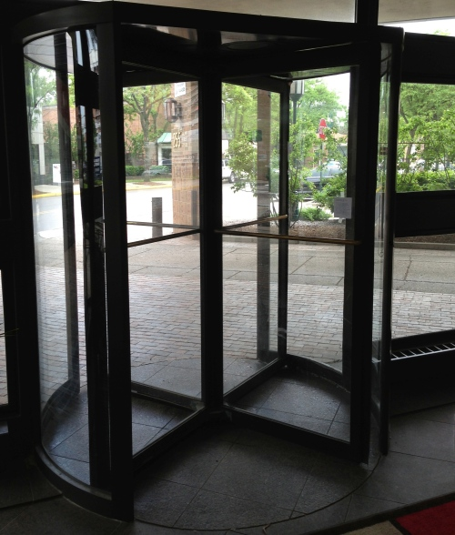poem is on revolving door, right-hand side