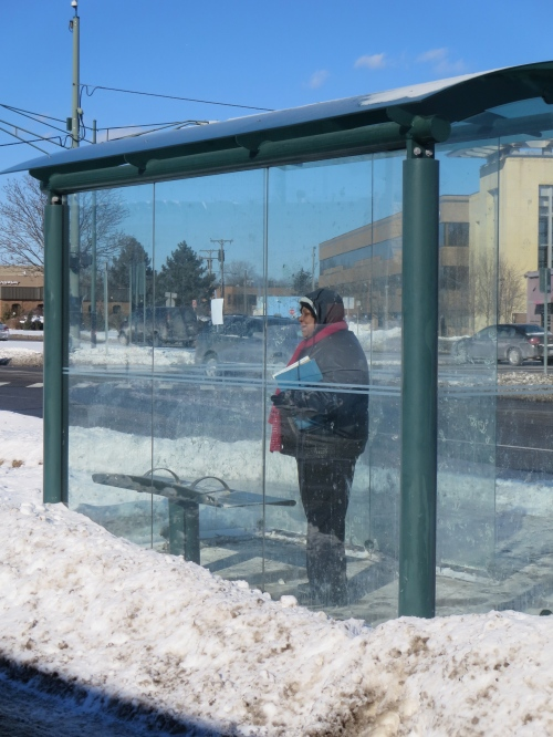 poem is on interior glass wall of bus stop